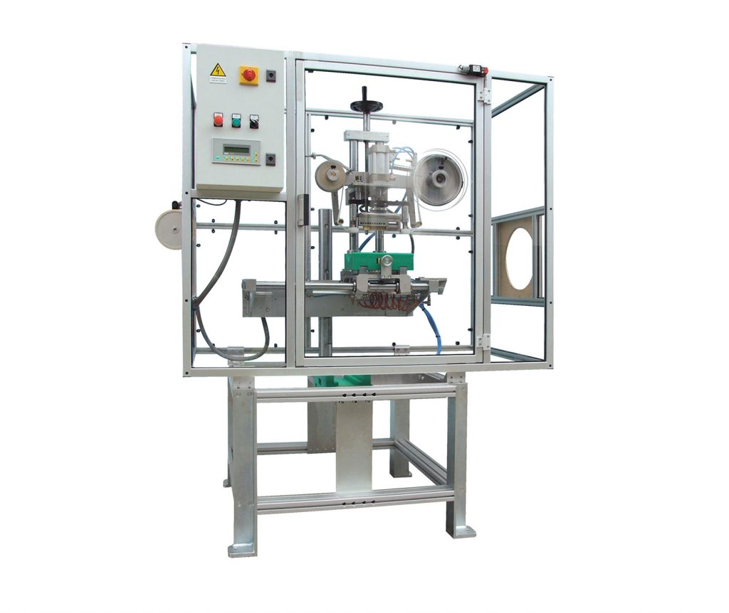Pneumatic hot marking machine with colored tape, for the production line of PVC pipes, profiles, sheathing, remote controls, and plastic parts with special sections.