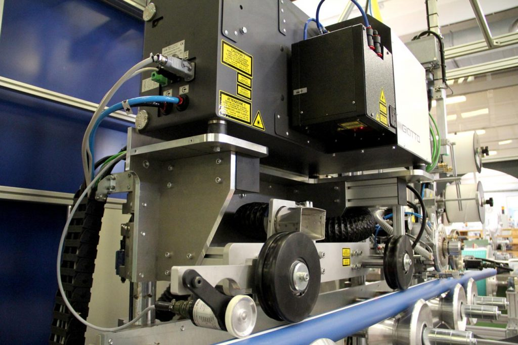 Detail of CO2 laser source and marking station for striping.